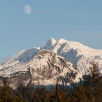 Moon over Snow-covered Mountains